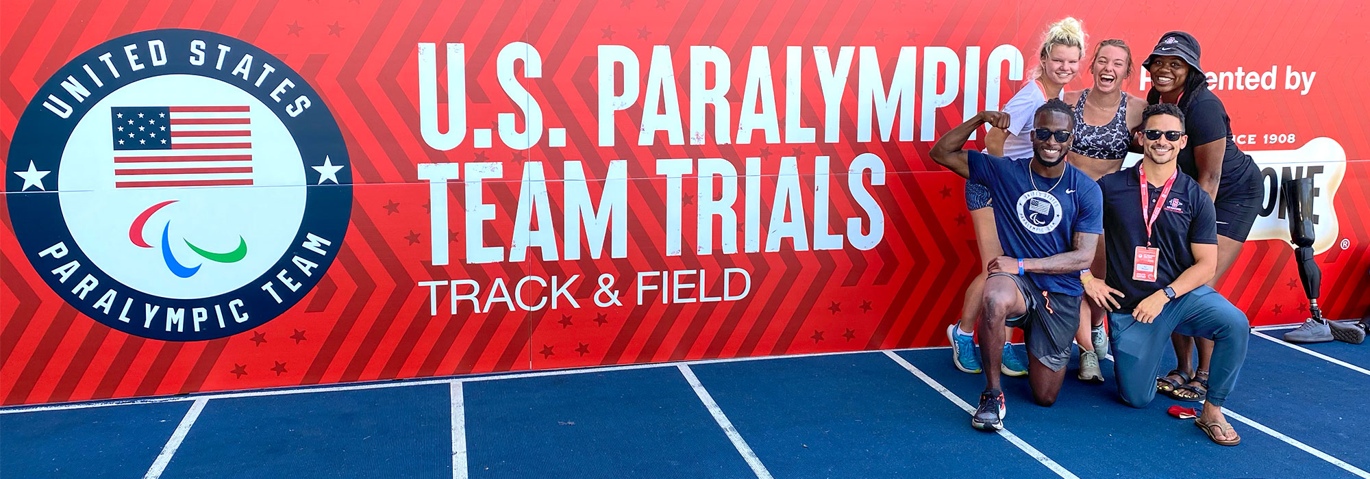 Adapted Athletics group in front of US Paralympic Team Trials Track & Field sign