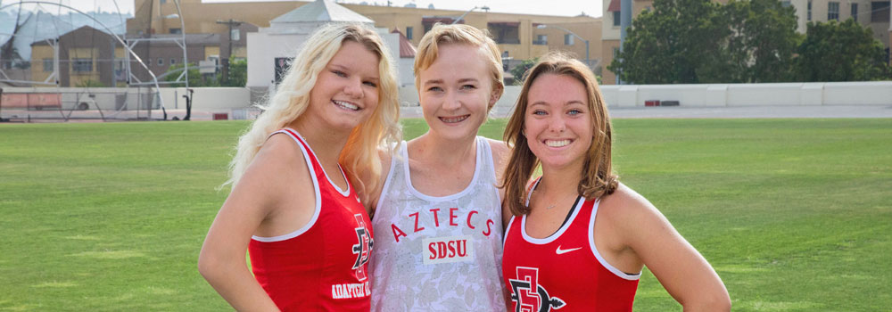 Three Adapted Athletics teammates smiling
