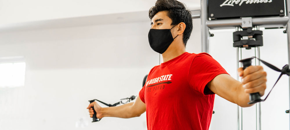 Working out at ARC Express with face mask