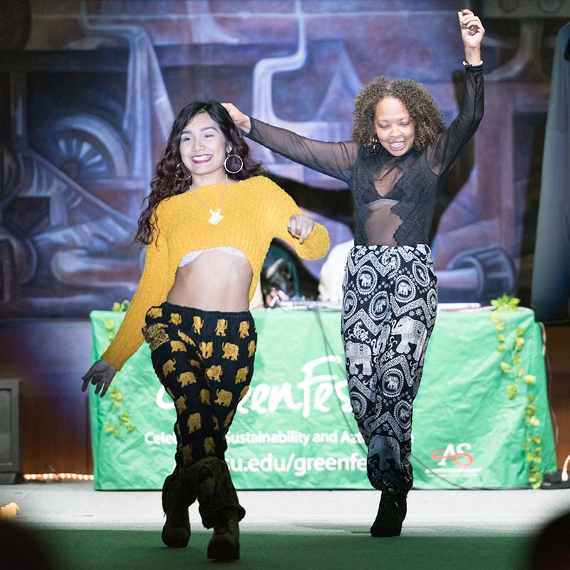 Two female students walking the runway at GreenFest Fashion Show