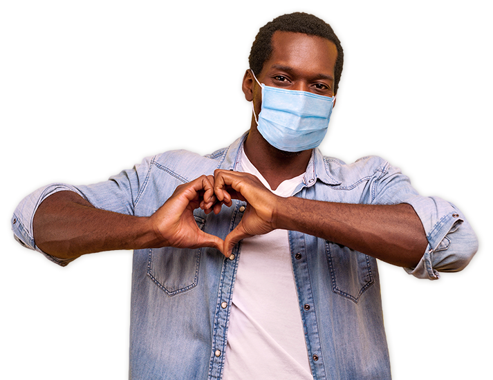 Guy wearing a mask making a heart with hands
