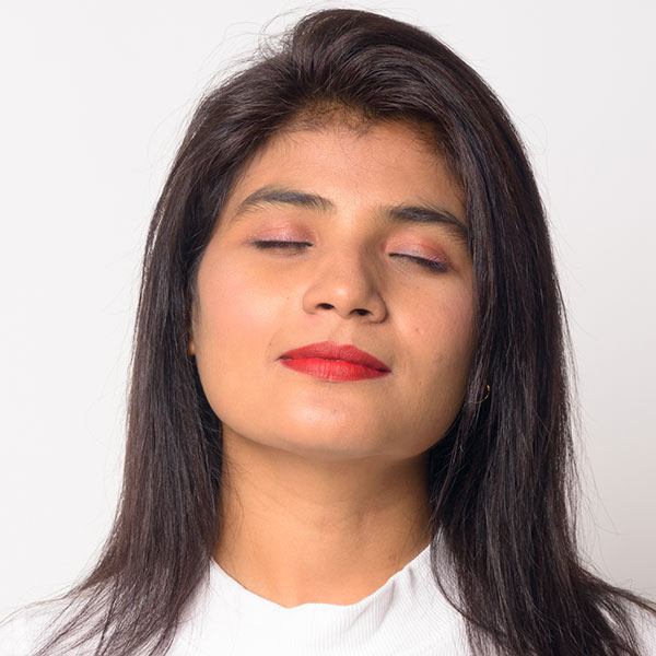 Photo of a woman with her eyes closed