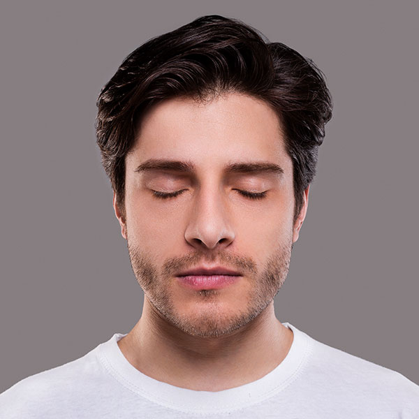 Photo of a man with her eyes closed