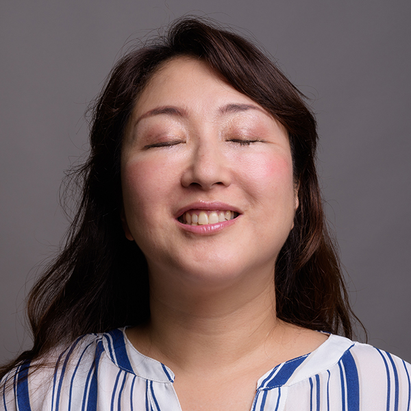 Photo of woman with her eyes closed smiling